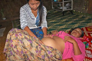 Nang Htun providing prenatal care to villager.