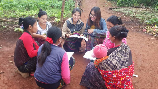 Dr. Nge Nge working with a group of women to improve their understanding of their health and resources.